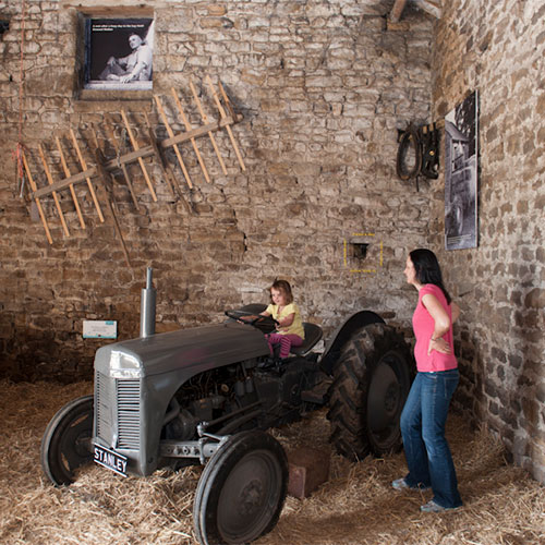 Historical barn and vintage tractor at Studfold